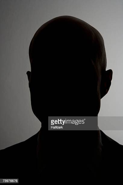 silhouette of a man - nicht erkennbare person stock-fotos und bilder
