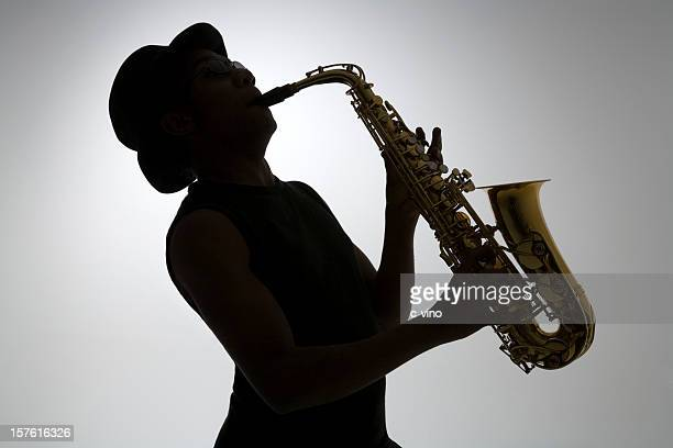 silhouette of a man playing the saxophone - jazz stock pictures, royalty-free photos & images