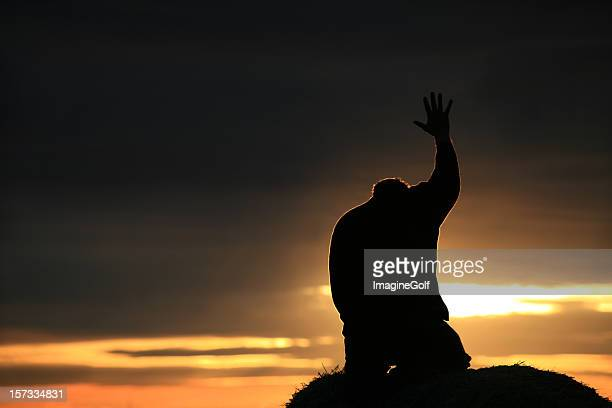 silhouette of a man seeking god - place of worship stock pictures, royalty-free photos & images