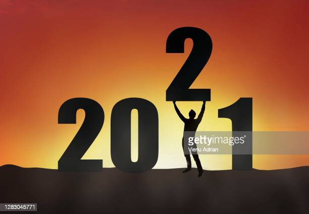 2021 silhouette of a man standing in the sunset, man empowerment , new year holiday greeting card - 2010 stock pictures, royalty-free photos & images