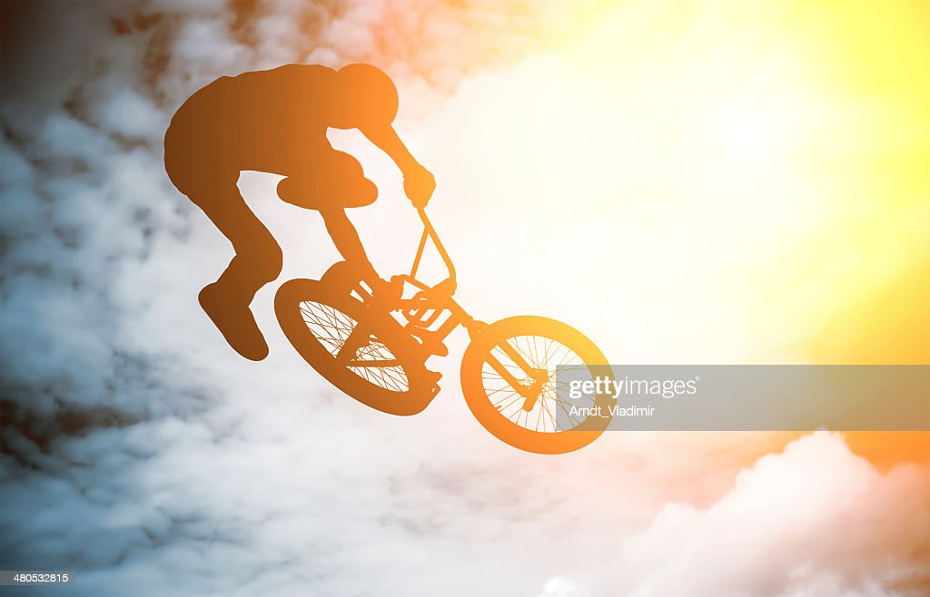 Silhouette of a man with a bmx bike. : Stock Photo