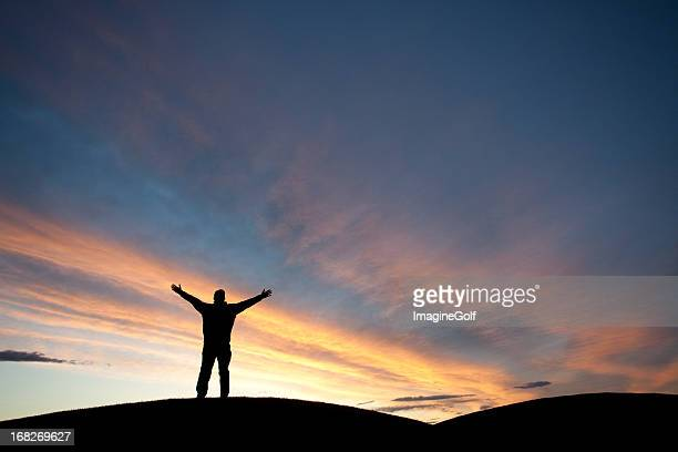 silhouette of a man with arms raised - wide stock pictures, royalty-free photos & images