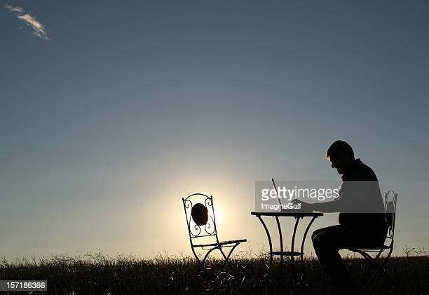 Silhouette of a Man Working Late Outside