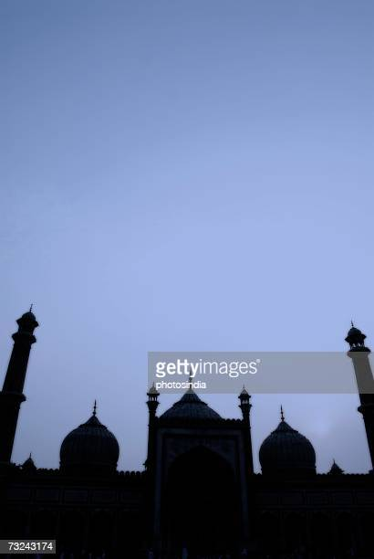 silhouette of a mosque, jama masjid, new delhi, india - jama masjid delhi stock pictures, royalty-free photos & images