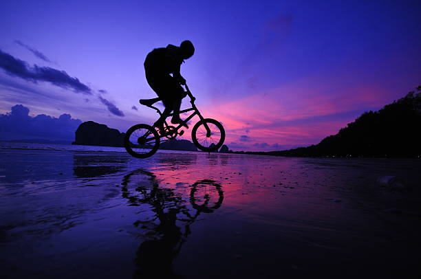 Silhouette Of A Mountain Biker On Beach And Sunset Wall Art