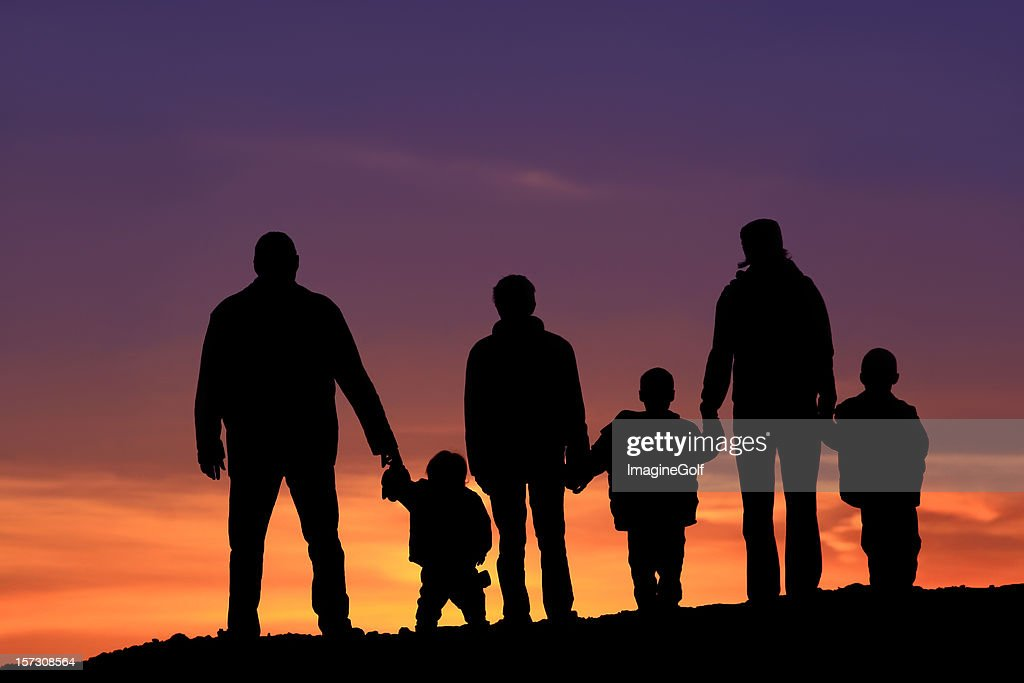 Silhouette of a Multi-Generational Happy Caucasian Family Holding Hands : Stock Photo