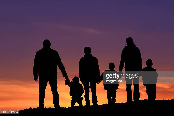 Silhouette of a Multi-Generational Happy Caucasian Family Holding Hands