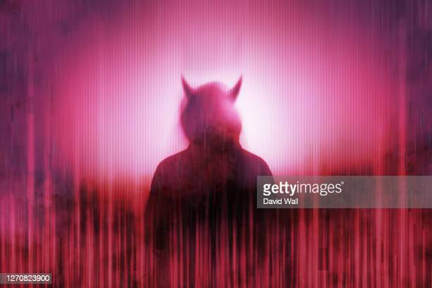 silhouette of a mysterious horned devil figure without a face, surrounded by a glitch, red, neon edit - devil stock pictures, royalty-free photos & images