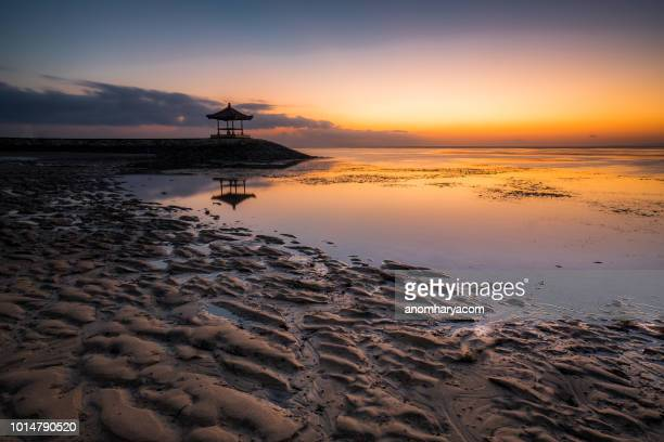 silhouette of a pagoda on beach, bali, indonesia - pagoda stock pictures, royalty-free photos & images