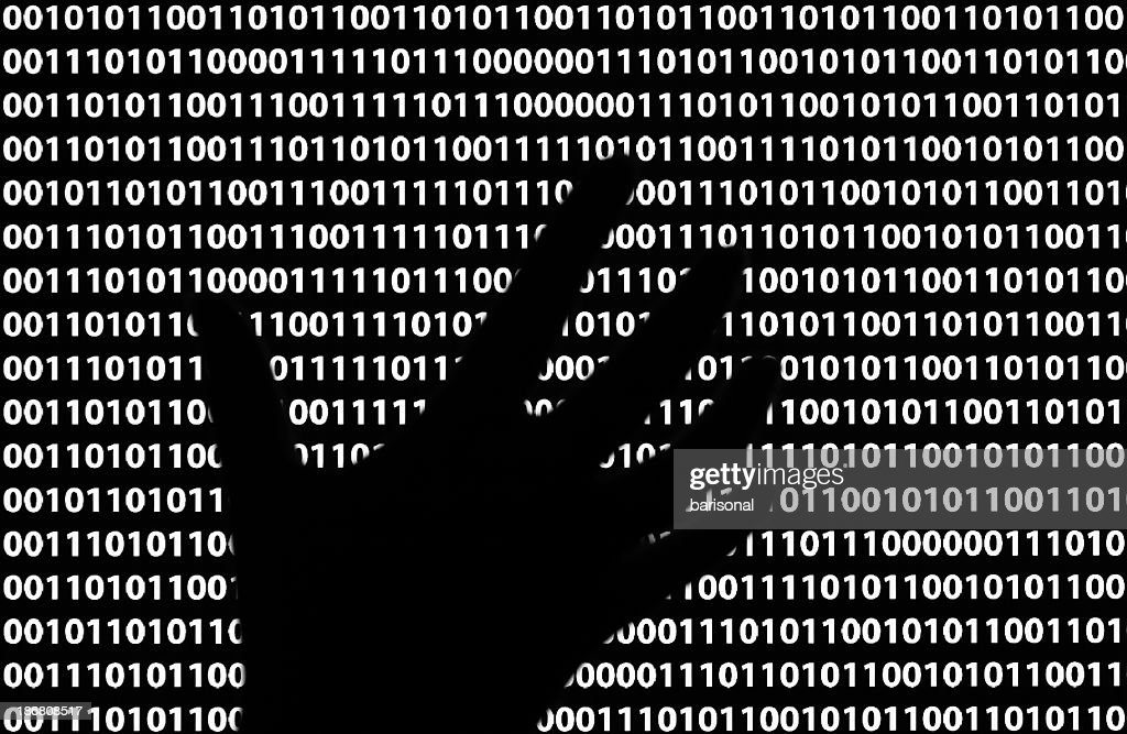 A silhouette of a person's hand through the lines of code : Stock Photo
