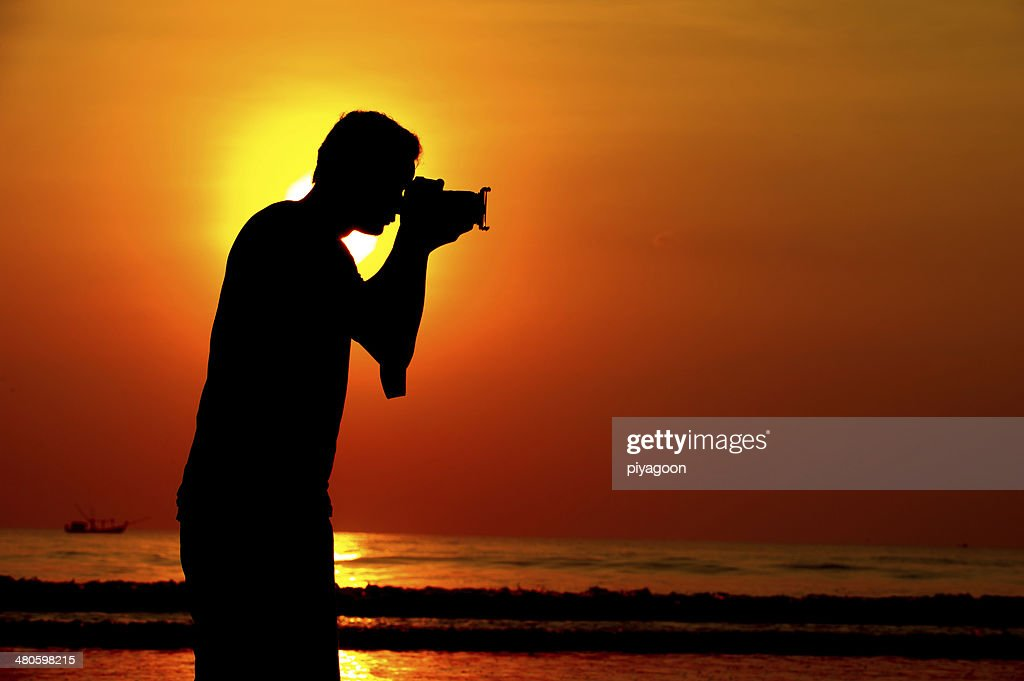 Silhouette of a photographer : Stock Photo