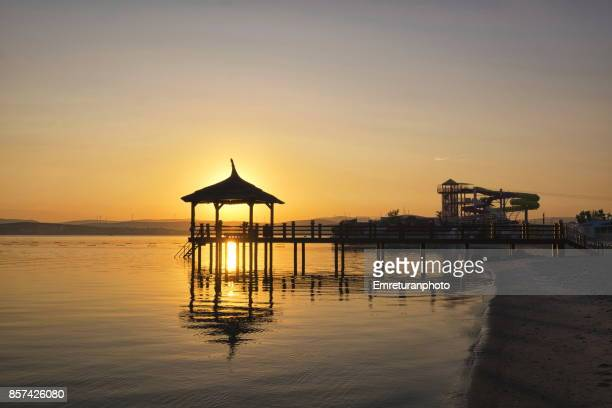 silhouette of a pier at dawn in cesme . - emreturanphoto stock pictures, royalty-free photos & images