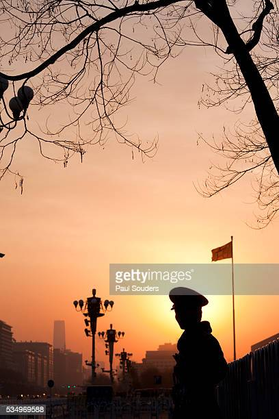 silhouette of a police officer at sunrise - tiananmen square stock pictures, royalty-free photos & images