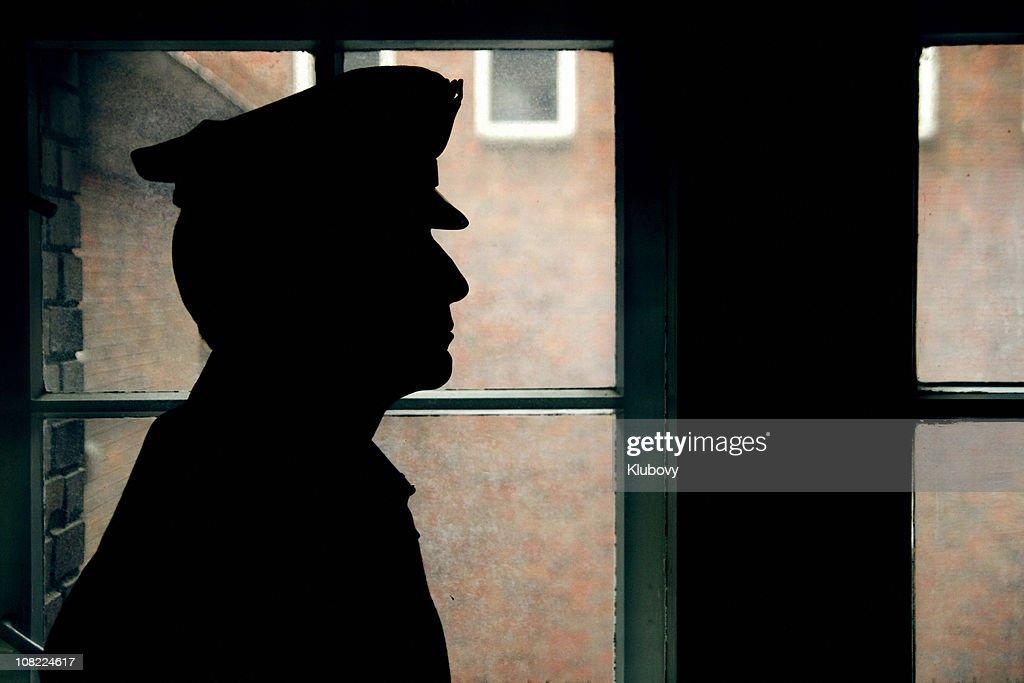 Silhouette of a prison/police warden : Stock Photo