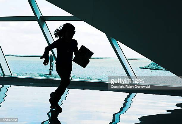 Silhouette of a running girl