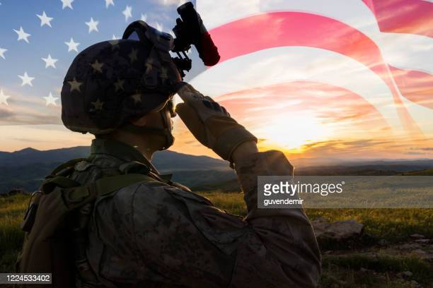 silhouette of a solider saluting against us flag at sunrise - armed forces day stock pictures, royalty-free photos & images