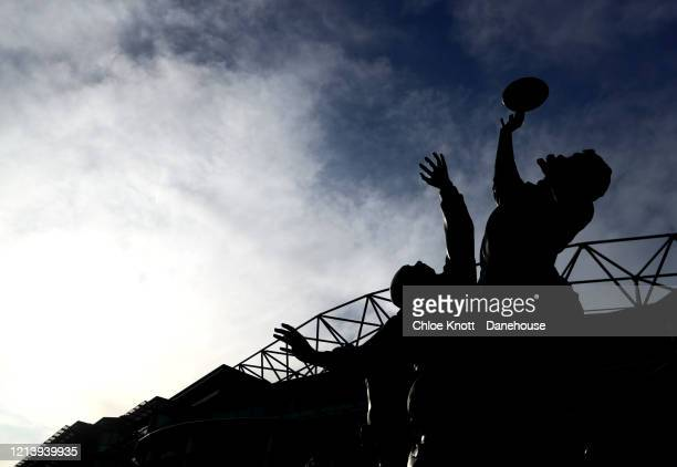 A silhouette of a statue outside of Twickenham Stadium is seen as rugby in England remains suspended due to Covid19 on March 21 2020 in London England