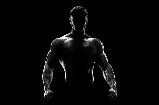 Silhouette of a strong fighter 479009182