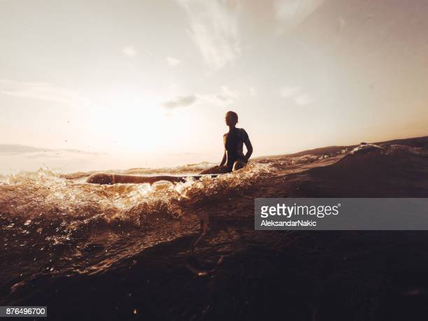 silhouette of a surfer girl - surf stock pictures, royalty-free photos & images