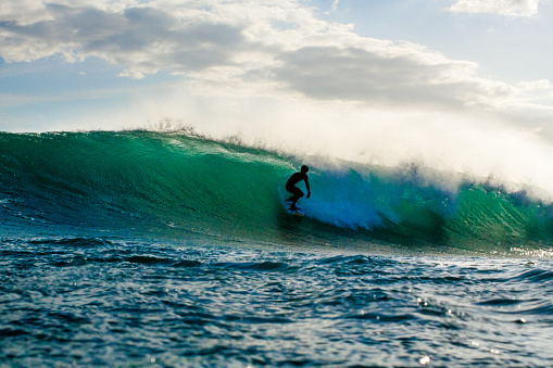 Silhouette of a Surfer Riding a Wave in Nicaragua - gettyimageskorea