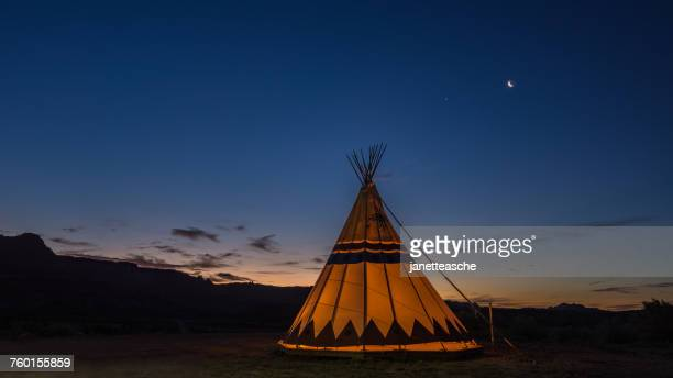 Silhouette of a Teepee tent at sunrise, Utah, America, USA