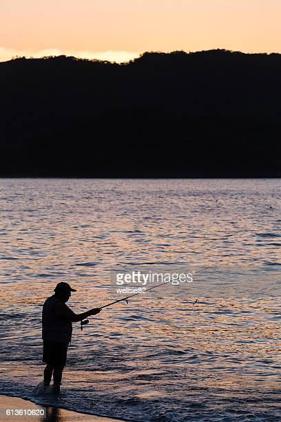 silhouette of a tico fishing - península de nicoya fotografías e imágenes de stock