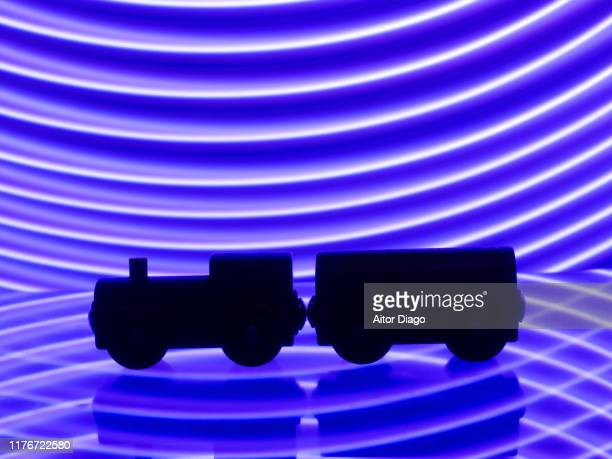 silhouette of a train in a modern blue environment - train engineer strike stock pictures, royalty-free photos & images