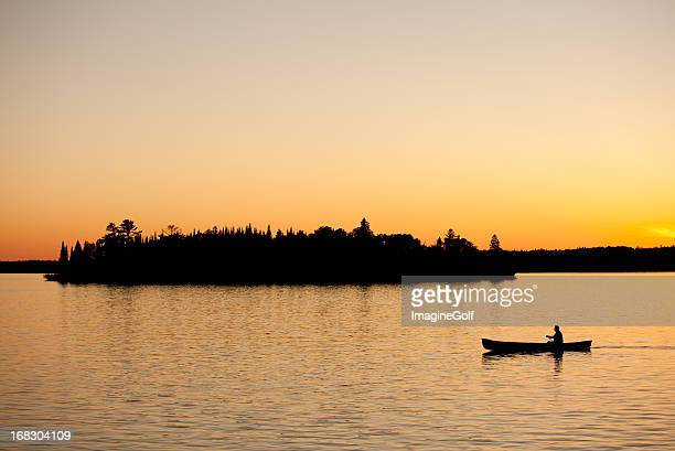 Silhouette of a Unrecognizable Male Canoeing in Ontario Canada