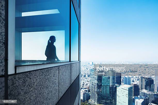 Silhouette of a Woman Overlooking Metropolis