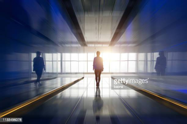 silhouette of a woman walking into the light - light at the end of the tunnel stock pictures, royalty-free photos & images