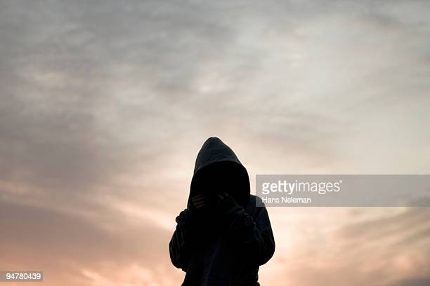 silhouette of a woman wearing a robe, qingdao, china - hans neleman ストックフォトと画像