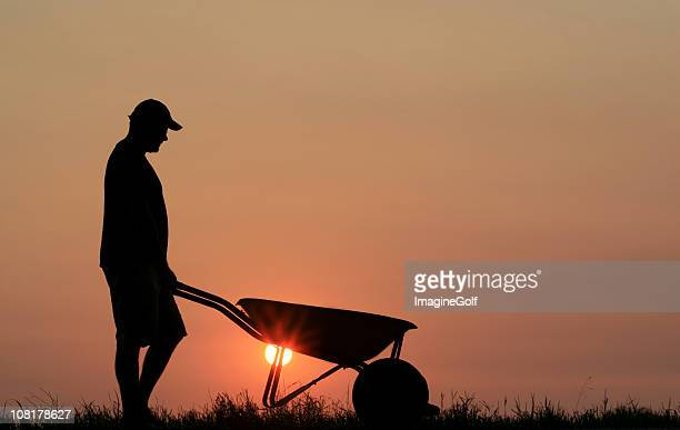 Silhouette of a Young Man Doing Yardwork