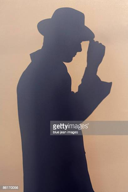 Silhouette of a young man in 1930's Style dress