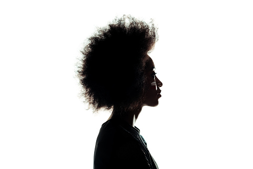 silhouette of african american woman with afro hairstyle isolated on white 912568140