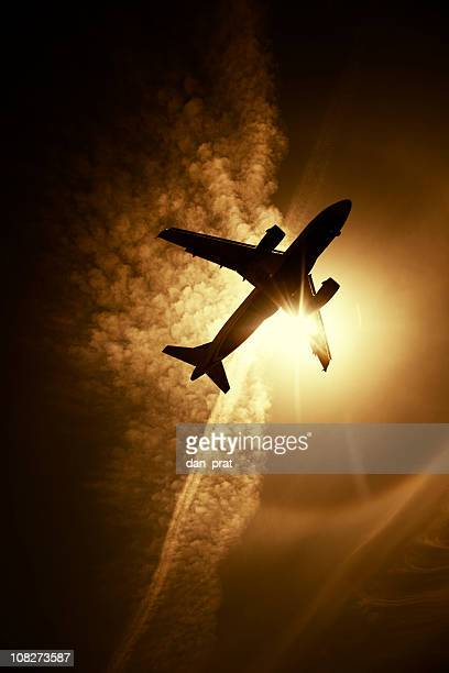 Silhouette of Airplane Flying in Sky, Toned