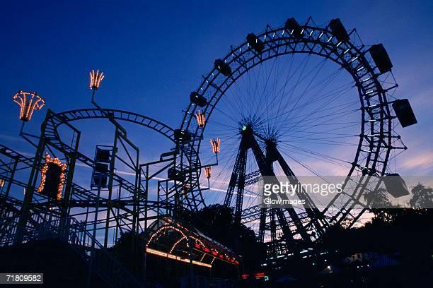 Silhouette of amusement park rides, Prater Park, Vienna, Austria