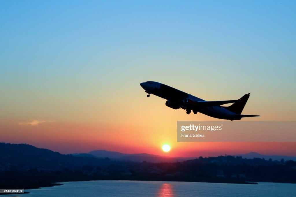 Silhouette of an airplane just after take off during sunset : Stock Photo