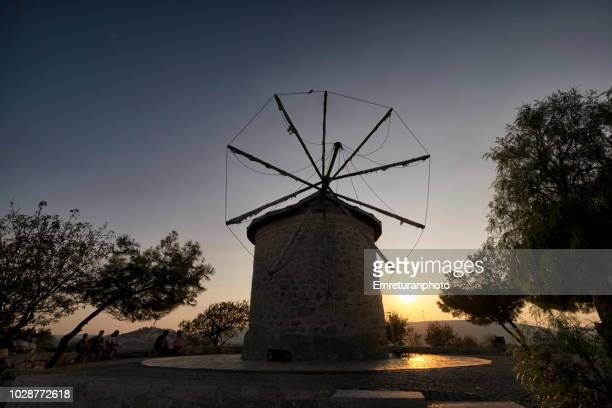 Silhouette of an old windmill at sunset.