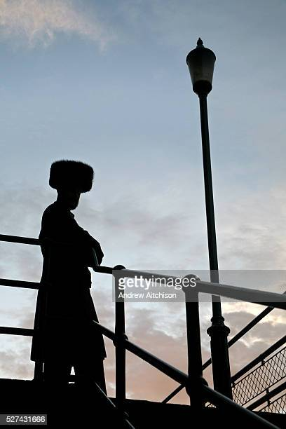 Silhouette of an Orthodox Jewish man wearing a furry hat called a Kolpik, traditional Slavic headdress worn on special occasions. This man is...