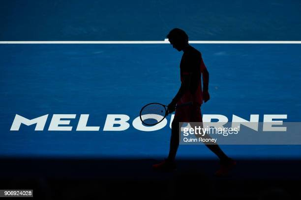 A silhouette of Andrey Rublev of Russia in his third round match against Grigor Dimitrov of Bulgaria on day five of the 2018 Australian Open at...