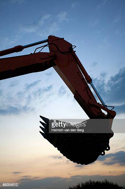 Silhouette of arm of excavator at sunset, Johannesburg, Gauteng, South Africa