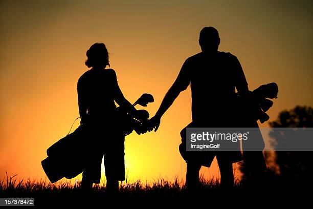Silhouette of Attractive Healthy Couple on a Golf Course
