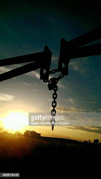 Silhouette Of Barrier Gate On Farm Field Locked During Sunset