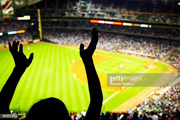 silhouette of baseball fan waving hands in the air - baseball sport stock pictures, royalty-free photos & images