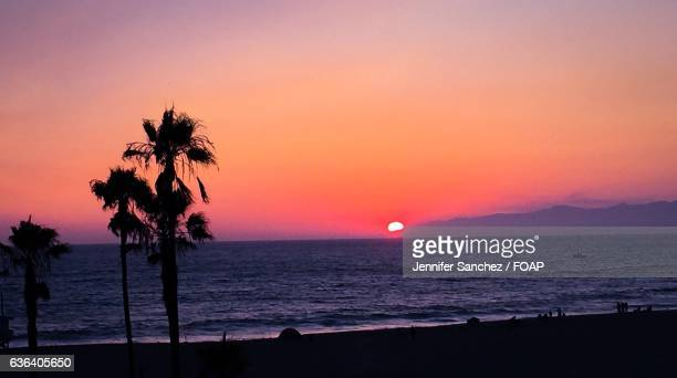 Silhouette of beach at sunset