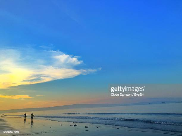 silhouette of beach during sunset - davao city stock photos and pictures
