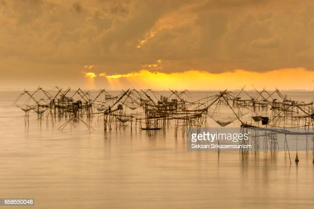 Silhouette of Beautiful Pak Pra lake, Pattalung, Thailand.