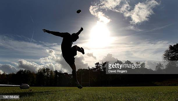 A silhouette of Ben Youngs as he practices his kicking during the England training session at Pennyhill Park Hotel on October 27 2010 in Bagshot...
