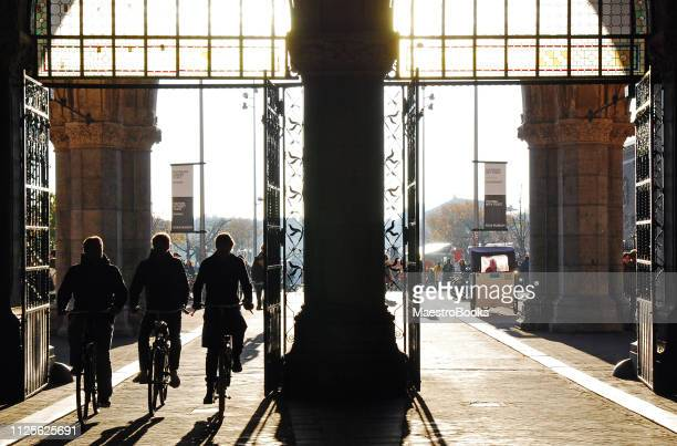 silhouette of bikers riding in amsterdam - museumplein stock pictures, royalty-free photos & images