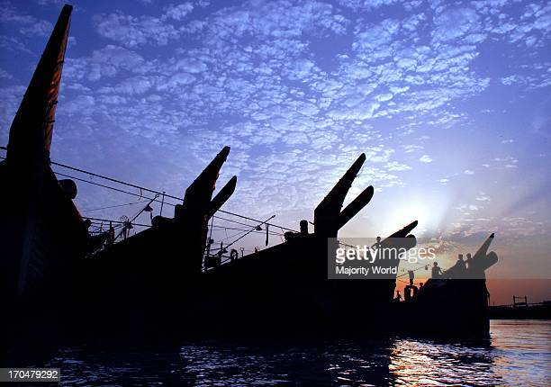 Silhouette of boats anchored in the Karnaphuli river in Chittagong the port city of Bangladesh May 20 2008
